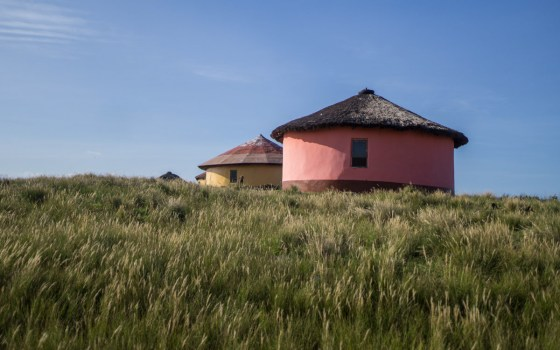 pink round or rondavel in tall grass in the Eastern Cape former Transkei South Africa
