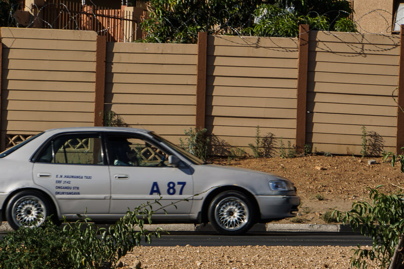 a grey taxi on the road in Windhoek West, Namibia