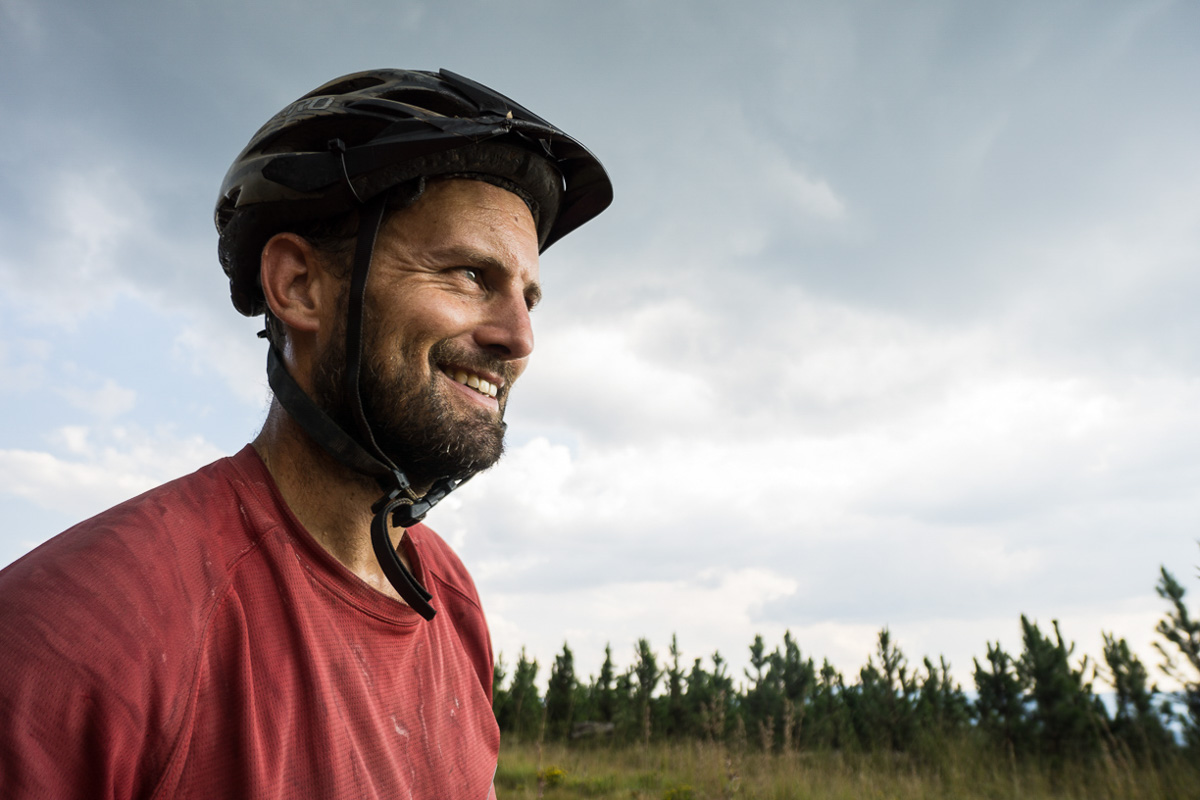 evan smiling on a cloudy day in the pine forests of northeastern south africa