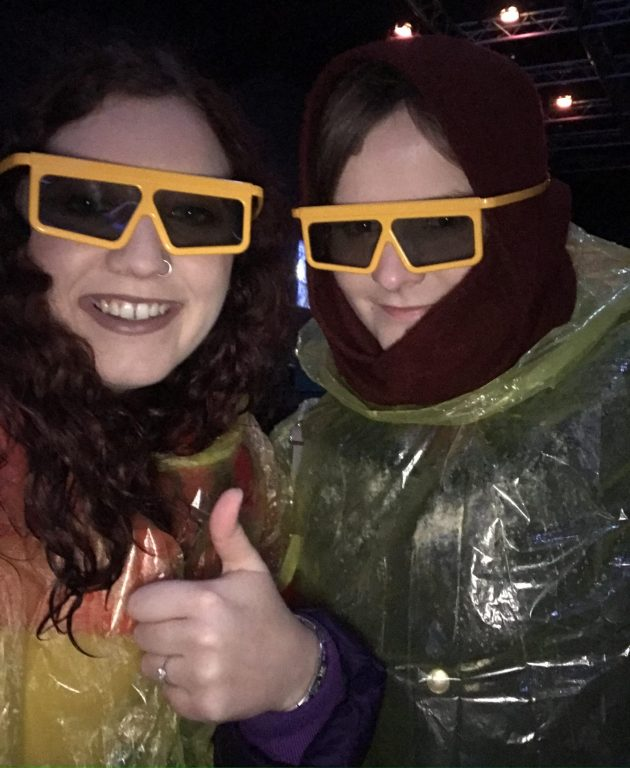 Megan and Amy wearing 3d glasses and yellow ponchos
