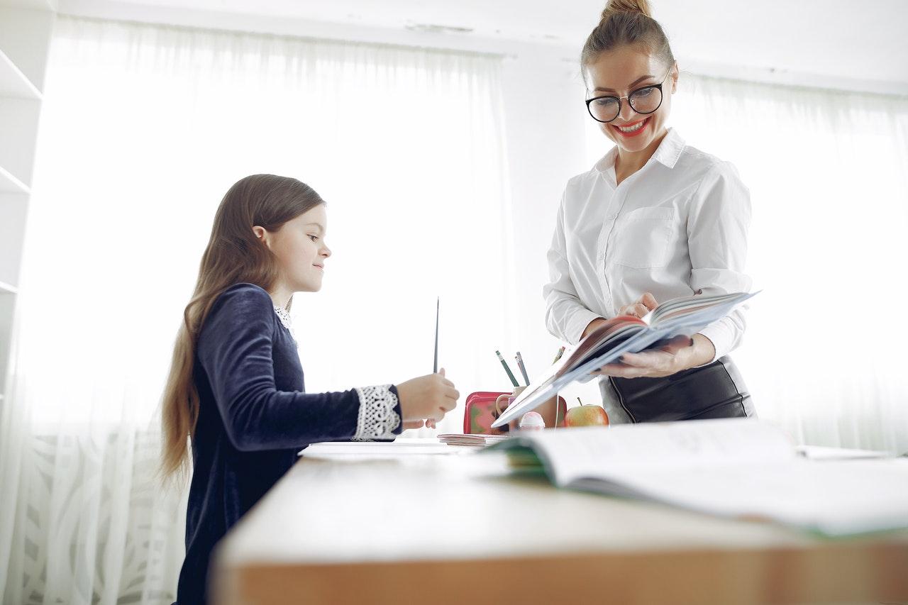 happy-tutor-explaining-lesson-to-pupil-4173338