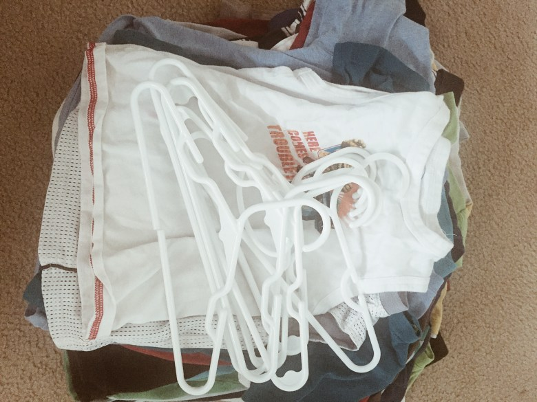 I leave a stack like this by their closet to let the boys know it's time to put the shirts on hangers.