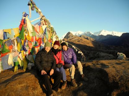 Cary, Martha, and Meg at sunrise. The Kangchenjunga Range in the distance.