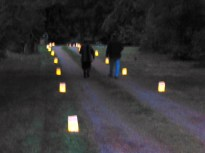 Residents place individual votives on loved one's graves