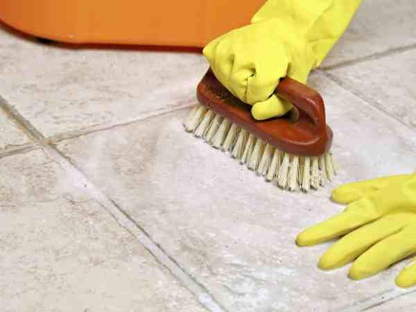 21968454 – hands in rubber gloves scrubbing the floor