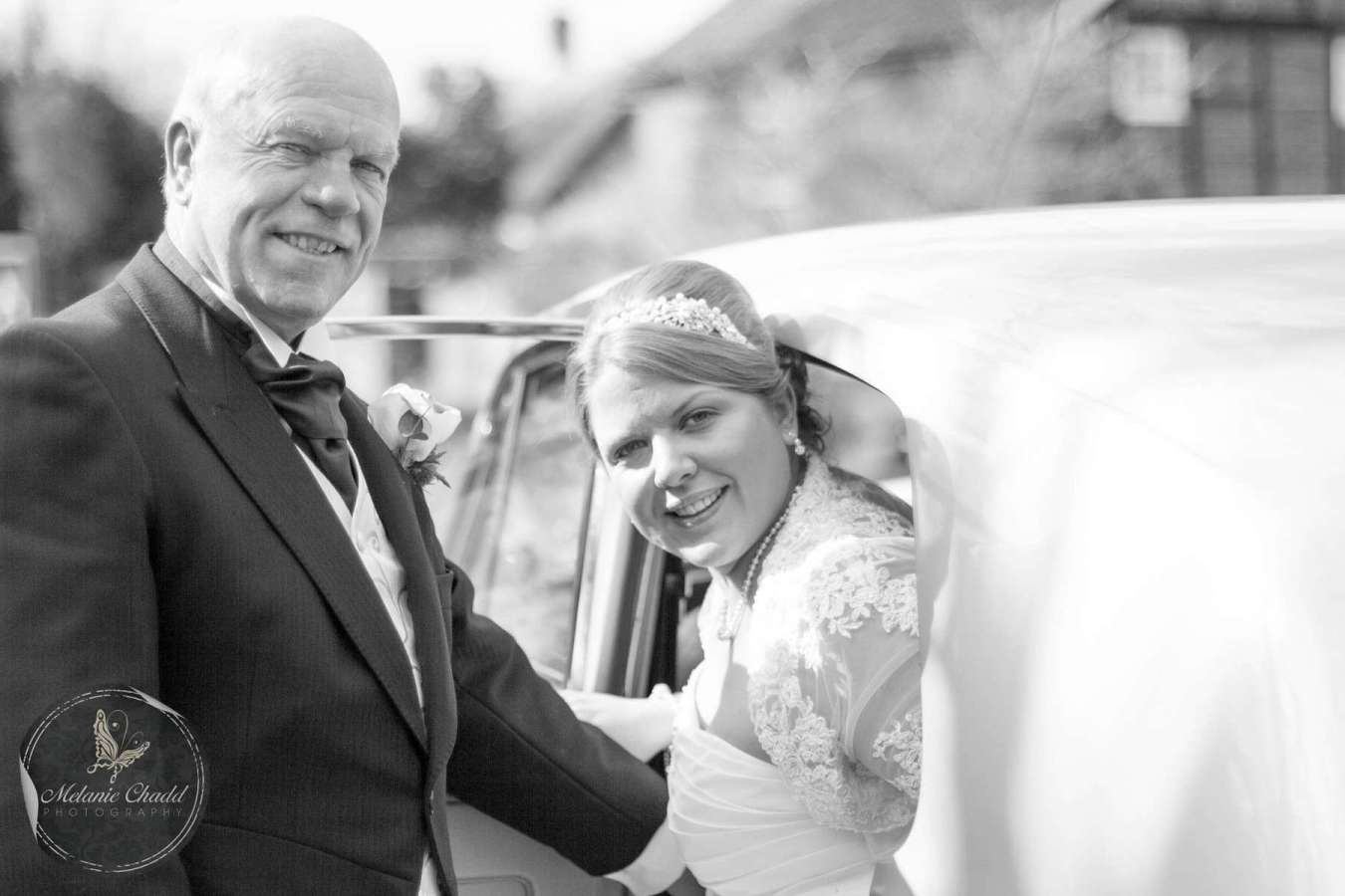 Bride arriving at the church with her Father