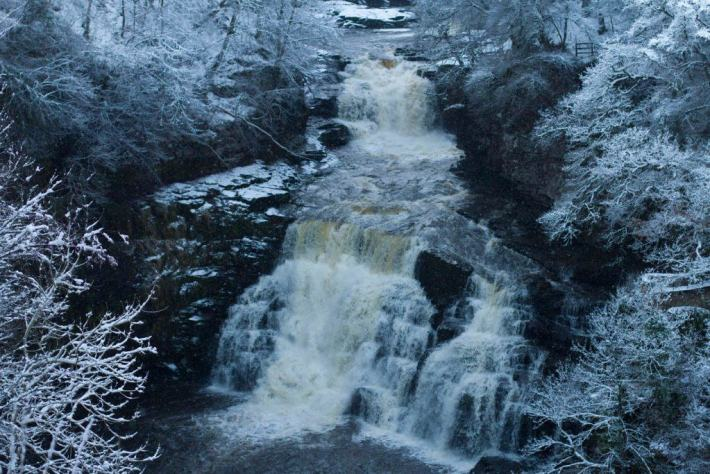 Photo of the Falls of Clyde. Snow on the surrounding trees