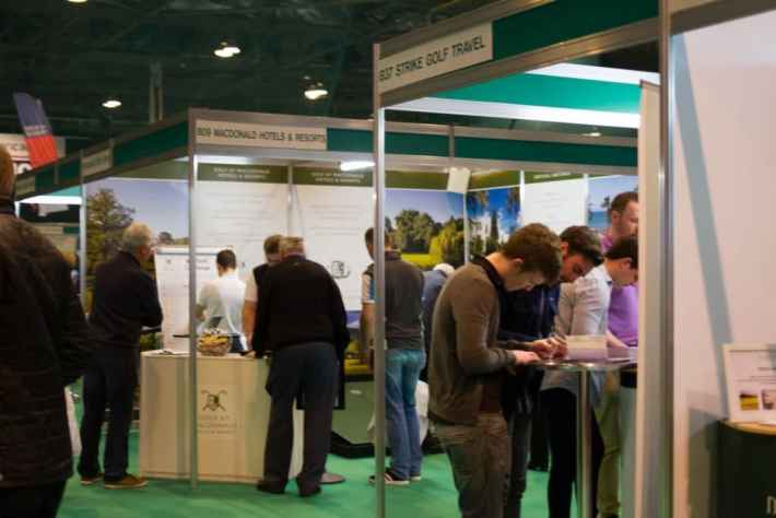 Photo of people at trade stands during the Scottish Golf show