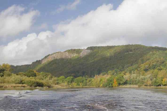 River boat trips, River Tay, Perth, Scotland. Photo of the river with a hill covered in trees in the background