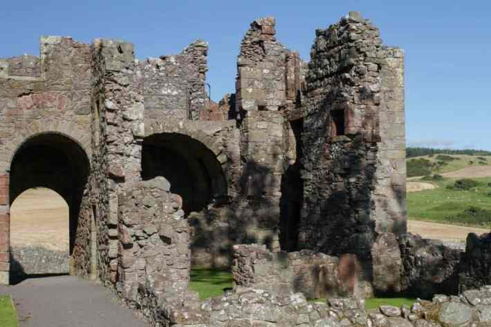 Balvaird Castle, Fife, Perthshire. Castle ruins. Archways and walls shown at the castle from ground level. Hills in the background