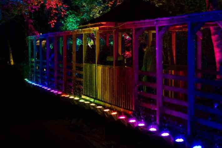 Enchanted Forest, Pitlochry, Perthshire. A rainbow coloured bridge in the dark
