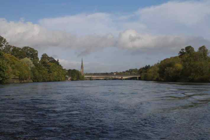 River Tay Boat trips, Perth, Scotland. Photo of the river Tay with the railway bridge and church spire in the background