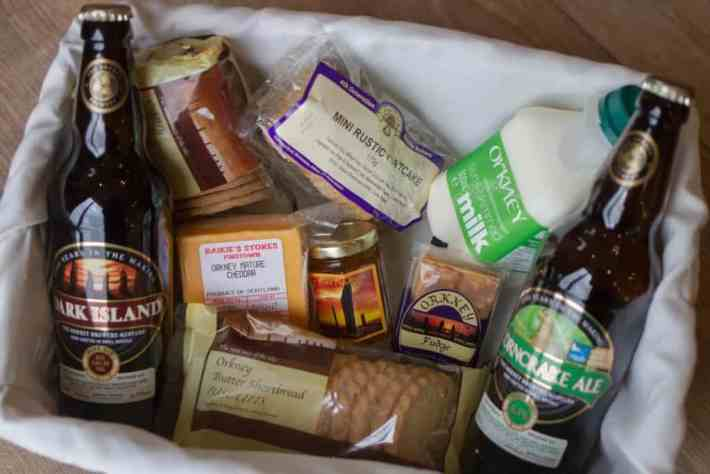 Local food hamper at Unigar Cottages. Cheese, bottles of beer, milk, fudge and oatcakes