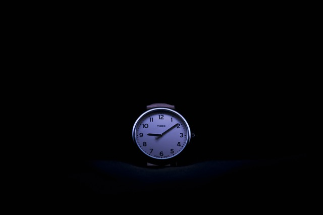 Watch against black background