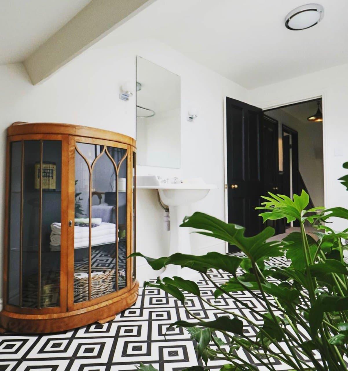 vintage cabinet, monochrome tiles