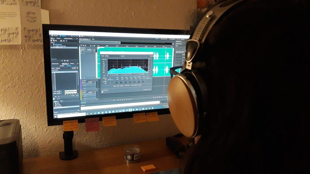Melanie Scroggins editing in her remote voice over home studio