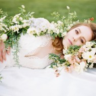bride in bed of roses styled by melissa chataigne _ michael costa