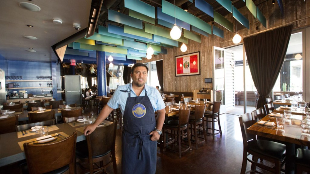 Chef Ricardo Zarate' at his Paiche LA Restaurant featuring hand painted blue and gold columns by Melissa Judson.