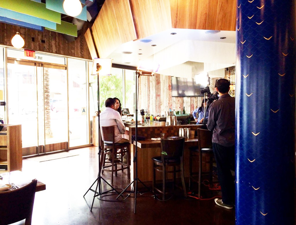 Interior of Chef Ricardo Zarate's Paiche LA Restaurant featuring hand painted blue and gold column by Melissa Judson.