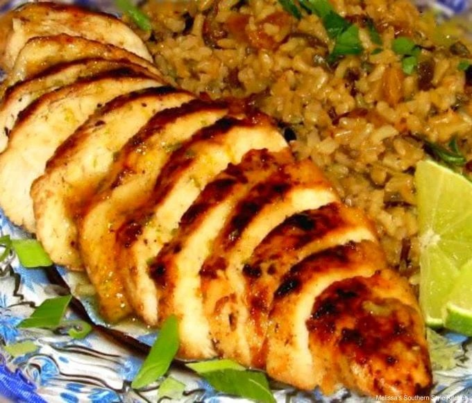 Caribbean Chicken sliced on a plate with rice pilaf