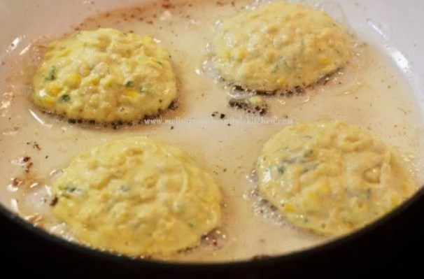 Frying corn cakes in a skillet