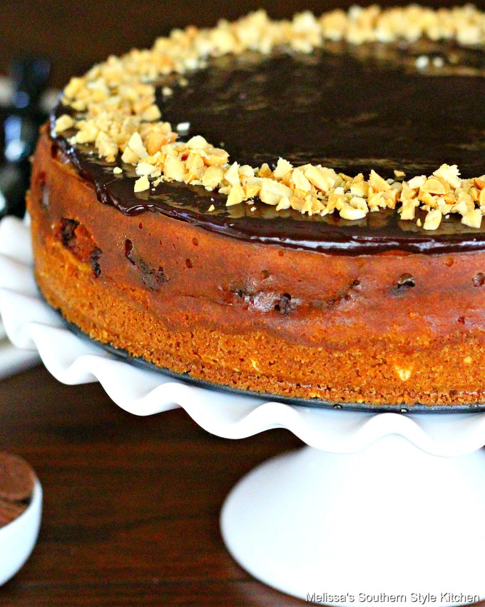 Peanut Butter Cup Cheesecake on a white cake pedestal