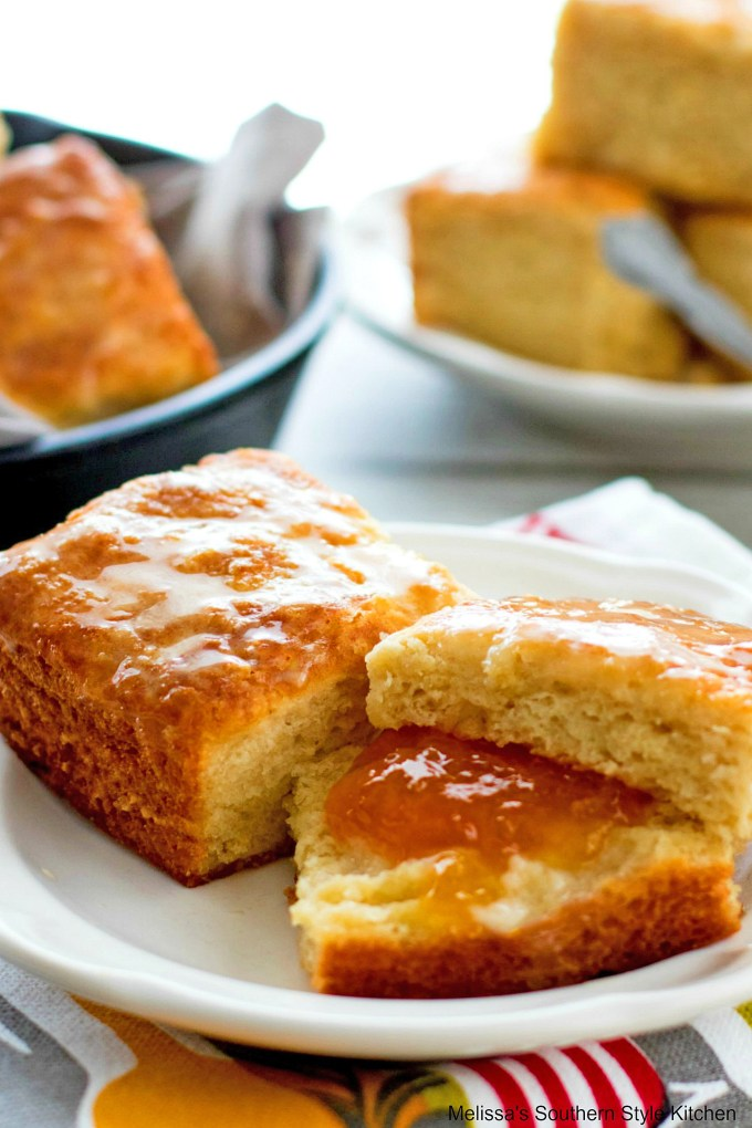 Fluffy Butter Biscuits with butter and jam on a plate