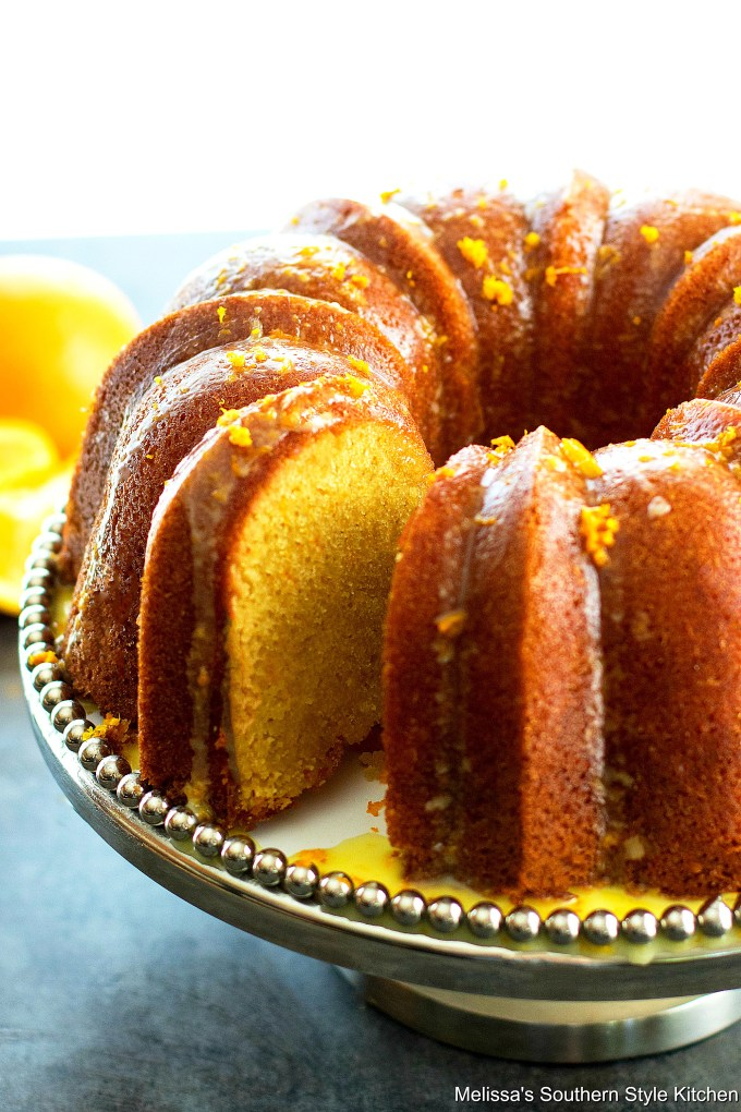 Sliced Orange Pound Cake on a cake pedastal