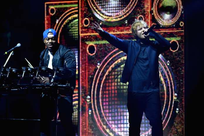 Ed Sheeran performs with DJ Locksmith of Rudimental during the MTV EMA's 2015 . (Photo by Brian Rasic/Getty Images for MTV)