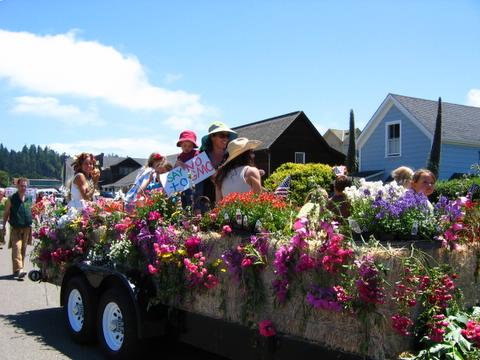 parade float covered in flowers