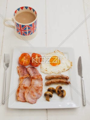 Cooked English Breakfast With Cup Of Tea
