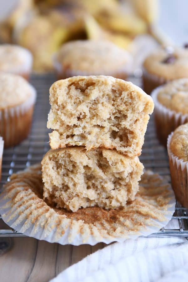 the best banana muffins - muffin split in half and stacked on each other