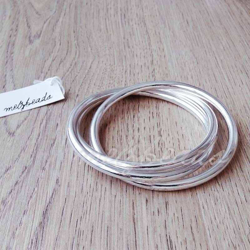 interlocking silver bangles