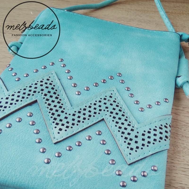 Teal leather crossover bag