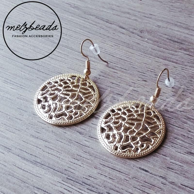 Gold circle earring