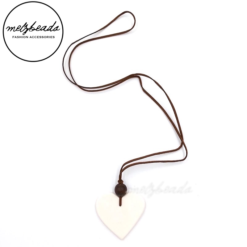Long White Heart Shaped Resin Pendant Necklace