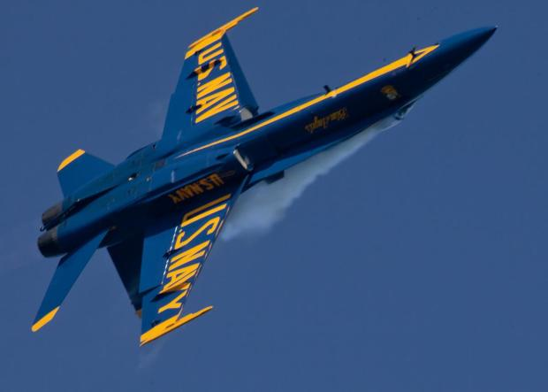 Blue Angels F-18 in a tight turn over the St. Francis Yacht Club, San Francisco