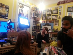 The cast and crew surrounded by VHS tapes. January 2015