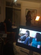 Lauren A. Kennedy and Sarah Schoofs on the monitor talking to Rory Lipede off camera.
