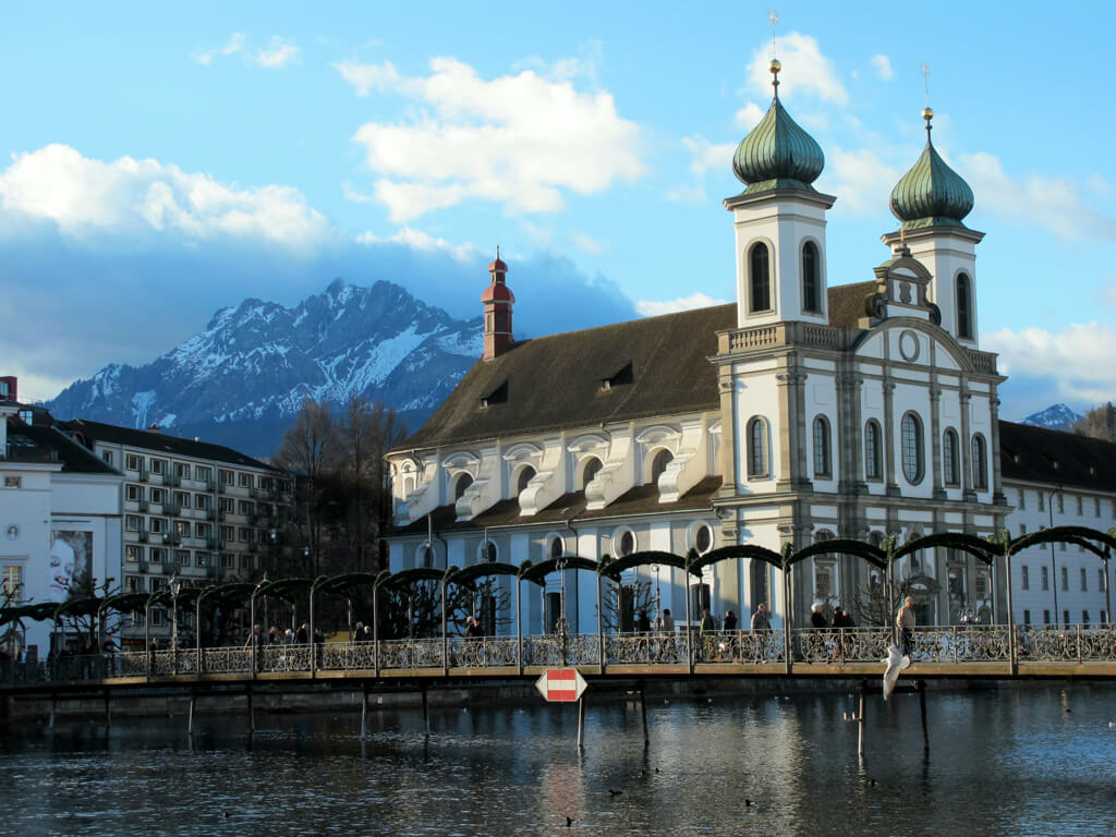 The Jesuit Church in Lucerne surrounded by mountains
