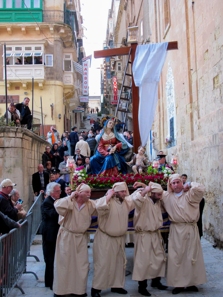 Men carry a statue of Mary through the streets of Valletta during an Easter procession