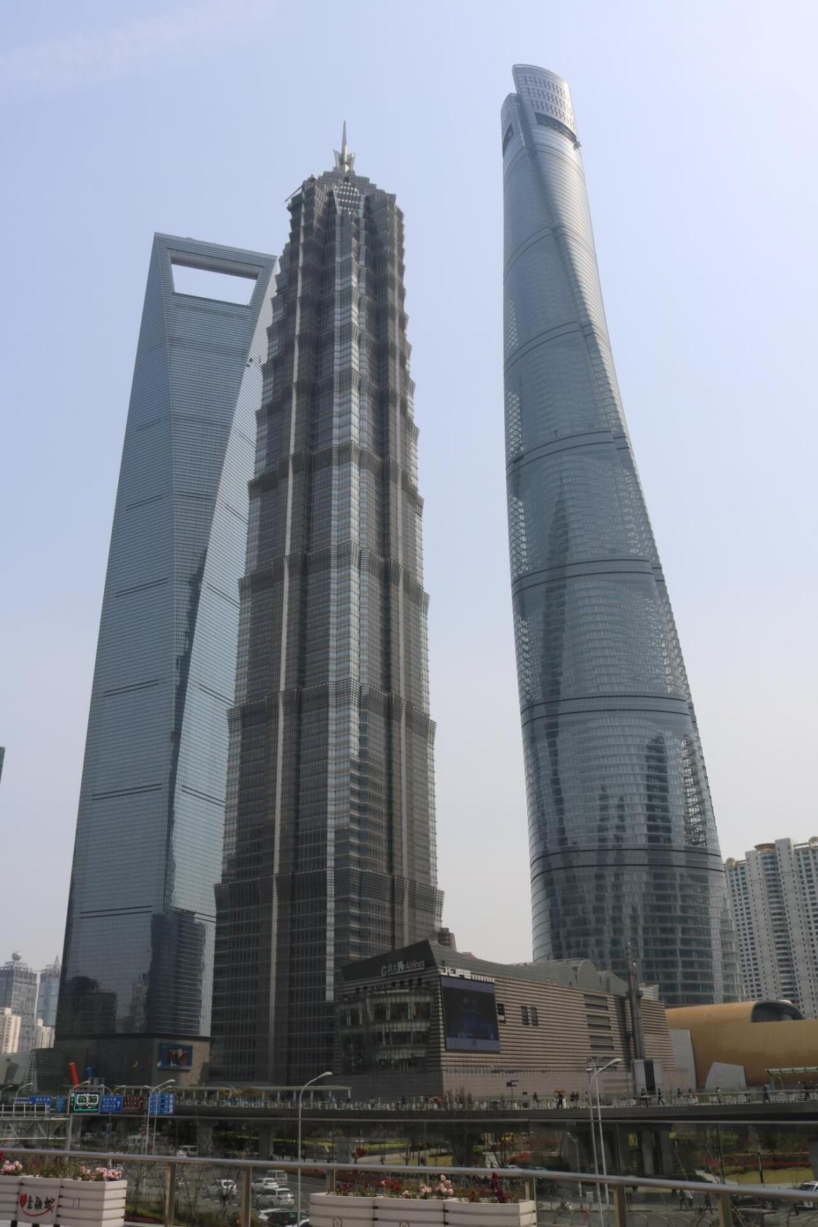 Shanghai World Financial Center, Jin Mao Tower, and Shanghai Tower.