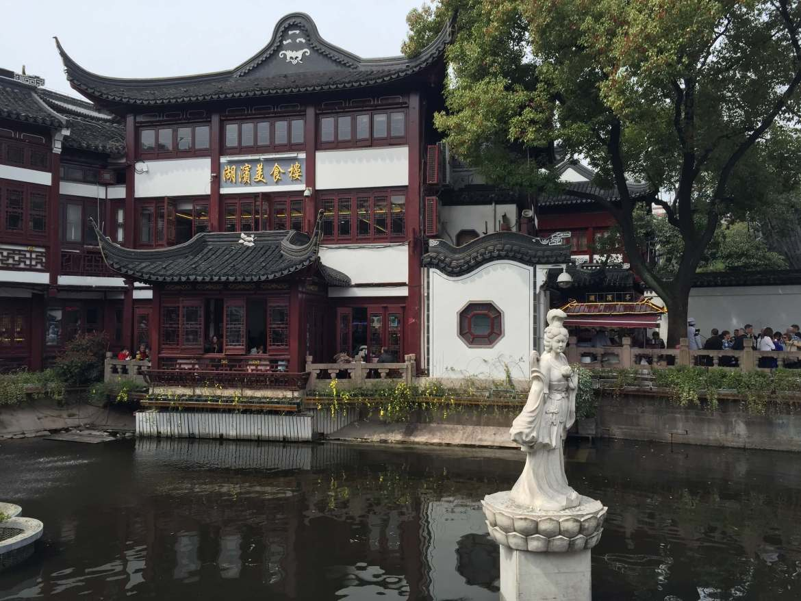A statue in a pond at Yu Garden