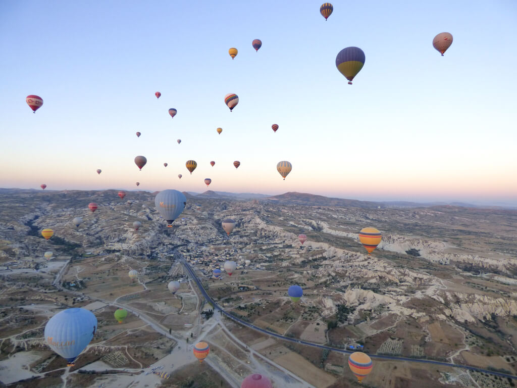 Many balloons in the air during sunrise in Cappadocia