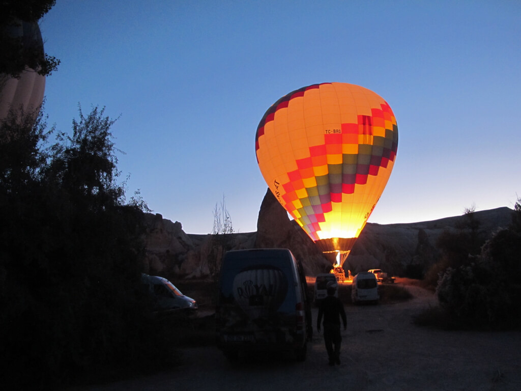 Preparing hot air balloons for takeoff in Cappadocia