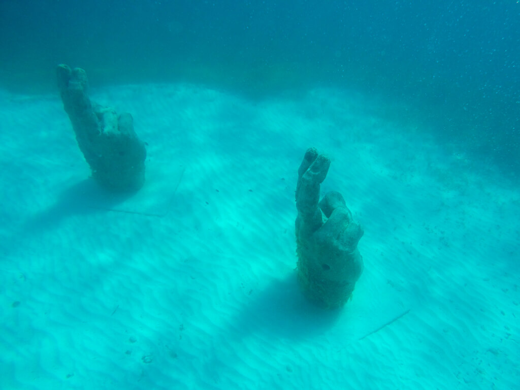 Sculptures of hands at MUSA, an underwater museum near Cancun and Isla Mujeres