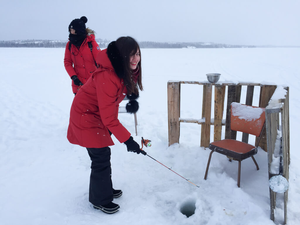 Travel blogger Memoirs of a Globetrotter tries ice fishing in Yellowknife, Northwest Territories, Canada