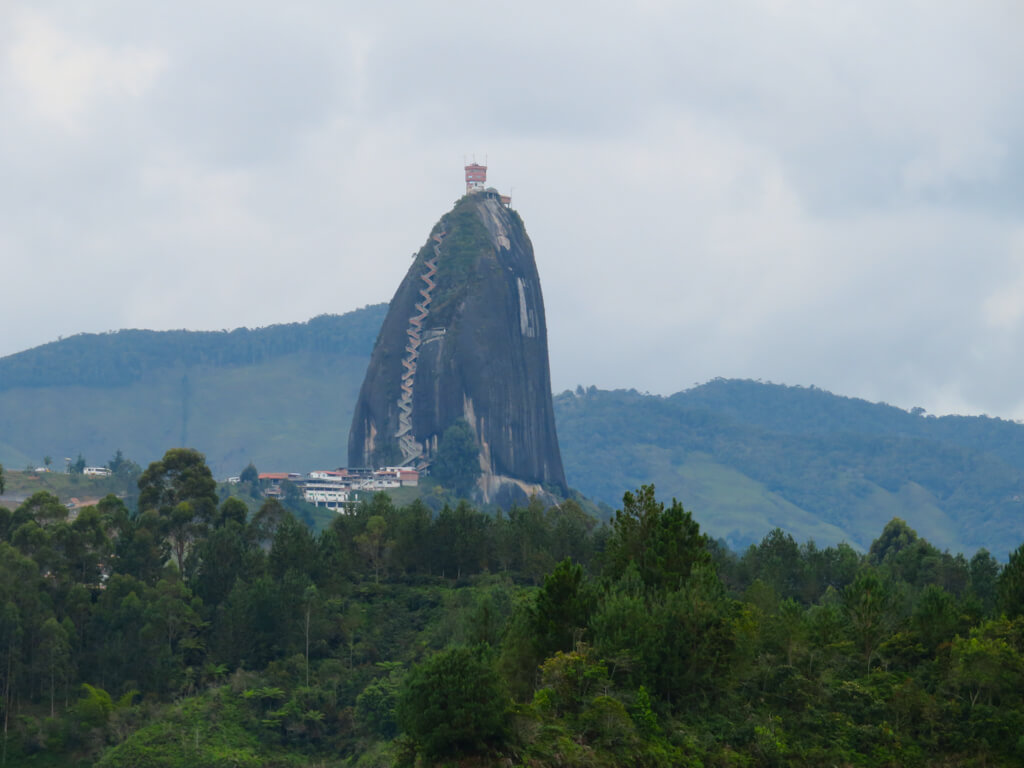 View of the rock of Guatape from a boat cruise on the lake.