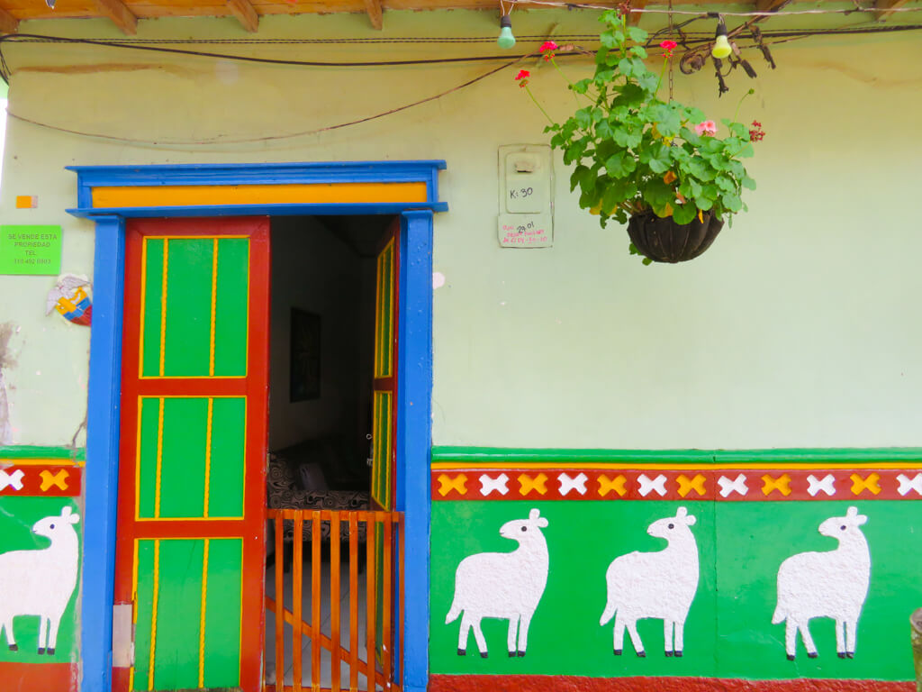A house in Guatape with llama zocalos