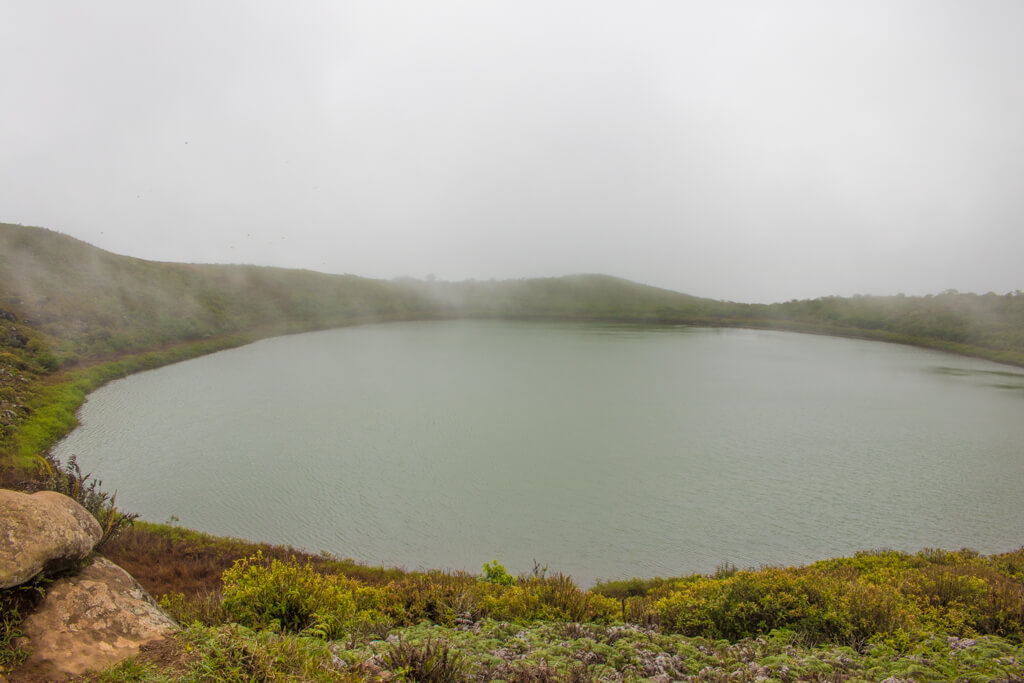 El Junco Lagoon is a crater lake located in the highlands of San Cristobal Island in the Galapagos. It is a source of freshwater for residents
